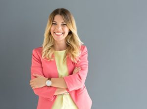 Business-dressed woman smiling